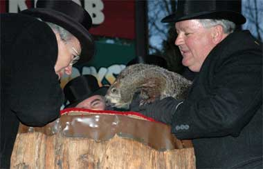 Punxsutawney Phil reads his proclamation.