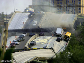 Vehicles are scattered along the broken remains of the Minneapolis Minnesota Interstate 35W bridge.